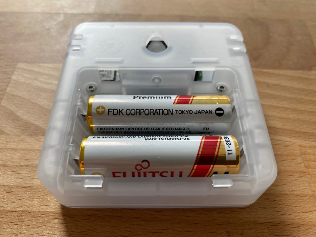 Two AA batteries powering the Aranet4 CO2, temperature and humidity sensor